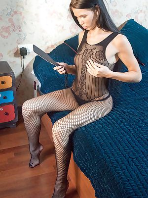 April rips her fishnet stockings as she plays with her pussy.