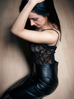Eva Kahil has a sexy surprise under her tight leather dress