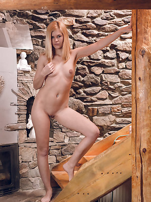 Delphine bares her slender, naked body as she plays with her dildo and finger-fucks her pussy.