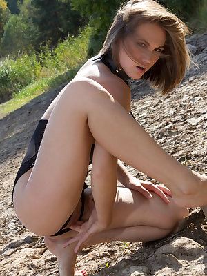 Mira V poses outdoors as she finger-fucks her yummy pussy with her erotic   outfit.