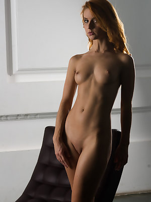 Seductive Roberta Berti strips and bares her sexy tight body, yummy ass and smooth pussy on the chair.