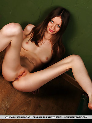 Kylie A bares her slender, naked body and yummy pussy as she   poses in front of the camera.
