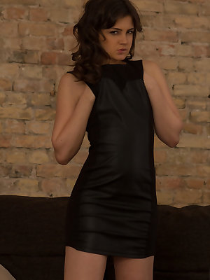 Mary M strips her black dress baring her nubile body as she masturbates on the   couch.