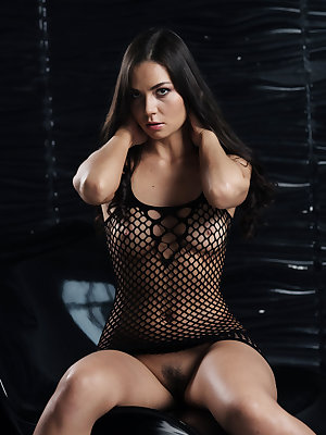 Lucy Kent strips her full body fishnet lingerie and shows off her smoking hot body with pery breasts and unshaven pussy in front of the camera.