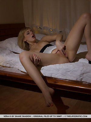Vera O erotically poses on the bed as she spreads her legs wide open and masturbates her yummy pussy.