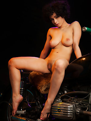 Pammie Lee strips her black ligerie baring her sexy curvy body and big breasts as she poses sensually on the motorbike.