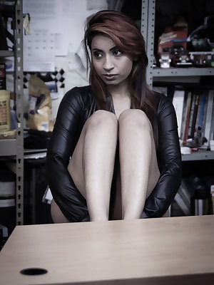 Maya Virdi takes off her leather jacket, revealing her smooth and petite body