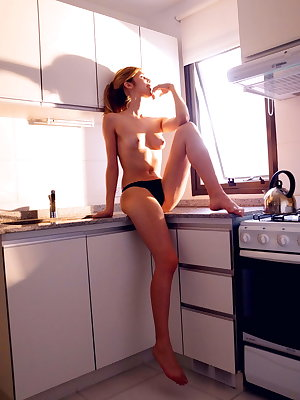 Katherine starts her day with a mind-blowing orgasm in the kitchen.
