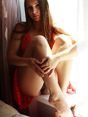 A naughty striptease of her red lace dress by the daring Alya, highlighting her luxuriously unshaven bush.