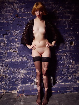 Against a a blue distressed wall, Sofia H's porcelain smooth skin and nubile body stand out.