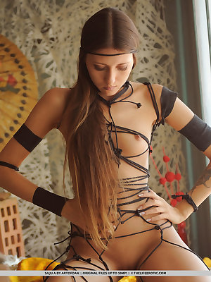 Exotic Saju A is bound by beautiful Shibari bondage  that accentuates her beautiful small breasts and delicate curves.  This captive goddess has her Samurai and is ready to engage in a lustful ritual with you.