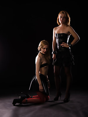 Juliya and Anna B in a titilliating series with lace and leather lingerie.