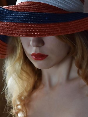Soft, curly blonde hair, smooth fair skin, red lips, and supple assets, May Shelton is simply delectable like ripe strawberries.