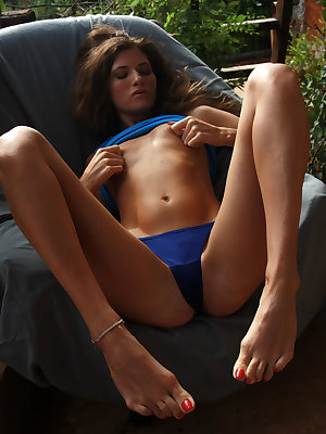 Salomja A takes off her blue top and sexy bikini panty to showcase her athletic body with perfect sunkissed skintone, perky nipples, and shaved pussy.