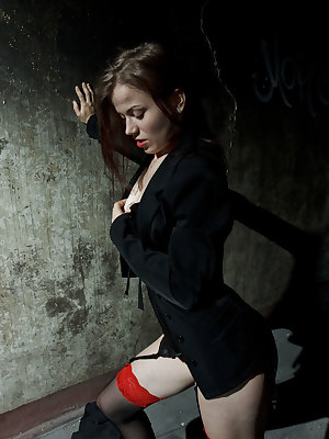 Izabella H feeling hot and horny in her black corset with matching panty, sheer stockings, and black strappy sandals.