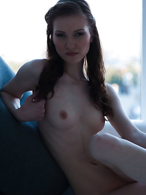 Nanova bares her petite body with smooth, creamy skin, puffy nipples and shaven pussy on the   sofa.