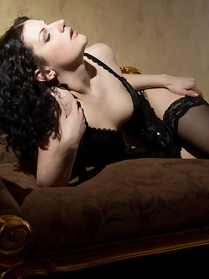 Clad in sheer black lingerie and matching stockings that accentuate her dark hair and sultry appeal, Zoe D gives in to her lustful desires.