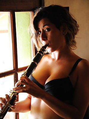 Matilde plays passionately with her clarinet before proceeding to play with her pussy.