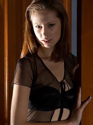 Alba A looks towards the mirror with sultry eyes that teases you to come closer.