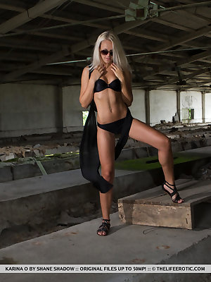Daring and adventuruous blonde Karina O stripping her all-black ensemble.