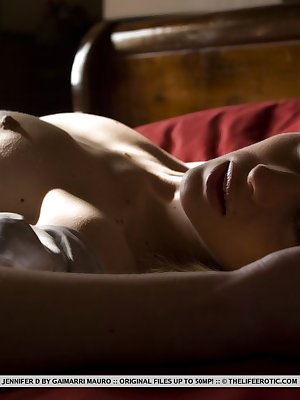 Jennifer D enjoys the peace and quiet in her room, and the soft, velvetly textures on her naked body.