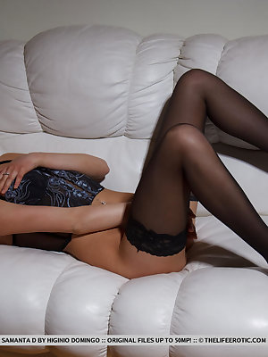 Wearing a gorgeous, sexy corset with matching black thigh-high stockings, Samantha spreads her sexy legs and masturbates her smooth juicy pussy.