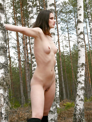 Wearing a knee-high black leather boots, Jouilie looks breathtaking as she poses sensually outdoors for her debut.