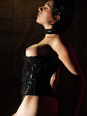 Wearing a super sexy black corset with matching frilly panty, and black hand gloves, the sultry Zeo puts on a dazzling cabaret show that highlights her magnificent assets.