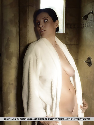 Jamie Lynn heads to the bathroom and takes a shower. With the cool water trickling down her sensitive body, she feels her libido rising and can't help touching herself.