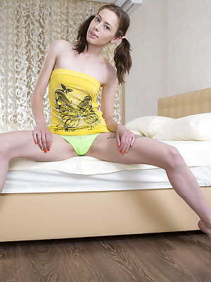 Vigorous slim brunette gets rid of her yellow clothing and shows off her moist areas in exciting poses and in a calming environment.