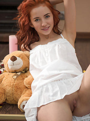 This kinky red haired teen loves to play around naked with her teddy bear that comforts her.