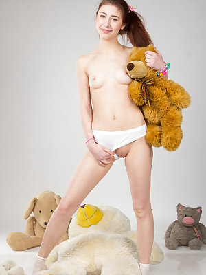 She always loved to play around with her toys and today she is showing off her fine teen pussy beside her favorite one.