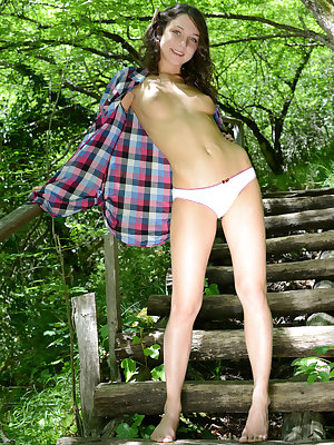 Teen adventures lead to interesting places in the forest, where she rests with some sexy naked poses and leg spreading.