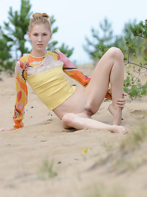 The hot sun and sand burns her hot teen booty as she slowly takes off every one of her clothes and spreads her long legs.