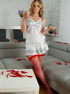 Gorgeous blonde teen splits her legs and shows off her red hot chili pepper pussy that will spice up any mans night.