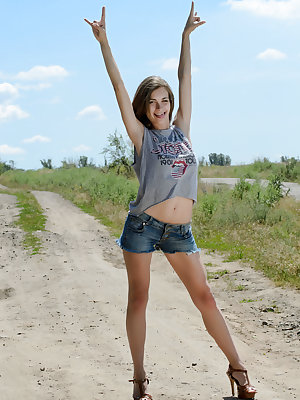 Stunning brunette teen gets naked on the road to her special place where she shows off her pink pussy with passion.