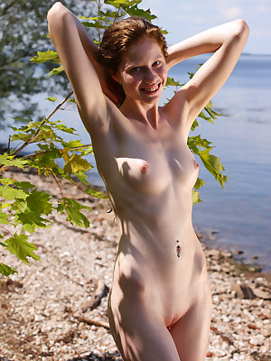 Alluring hot babe with mystic smile offer precious and unforgettable time in a fantastic natural environment. Extra natural beauty.