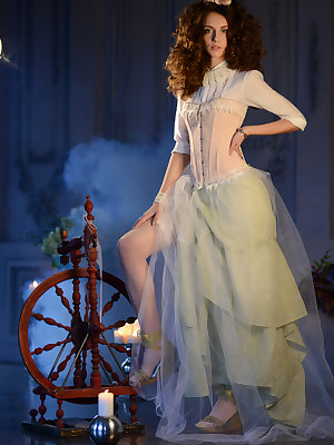 Vintage dress in baroque style enhances the loveliness of this brunette cutie. Hidden passion emerges after she drops the dress.