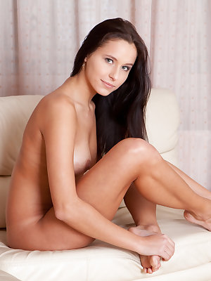 Soft skin, extra stretchy legs, lovely smile, busty breasts. This seducing brunette really knows how to take breath away.