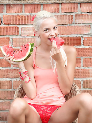 Slender teen gal eats some watermelon and does some sexy nude posing and spreading for us.