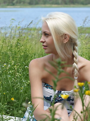 Pretty teen blonde shows her love for wild flowers along with her hot naked body outdoors.