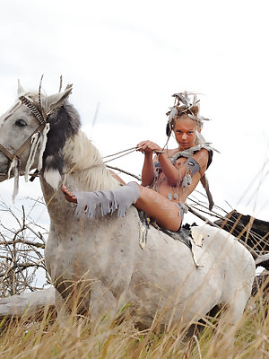 Extremely sensual petite teen girl rides a horse and artistically shows off her amenities.