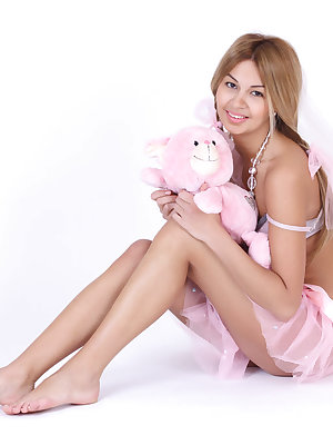 Cute teenie gets rid of her romantic pink outfit to show us her perfect naked tits and pussy.