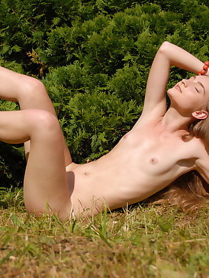 Passionate blonde girl poses completely naked outdoors and shows her sweetest spots.