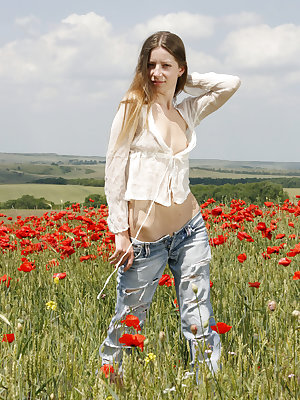 Long-haired teen girl loves tulips and this is the reason of her nude appearance in this beautiful place.