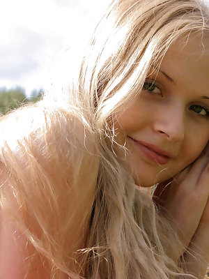 It is the best pastime for this good-looking nude teen to go to such secluded place as field and fondle her amazing treasures there.