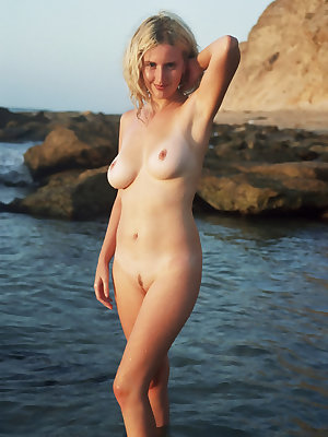 Warm water of the sea and beautiful view of sunset make sweet mermaid expose her irresistible body for you.