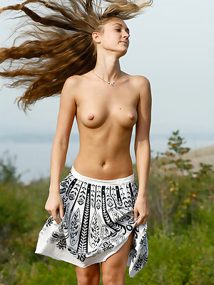 Will you let this irresistibly sexy long – haired girl enjoy you with her nice show outdoors?