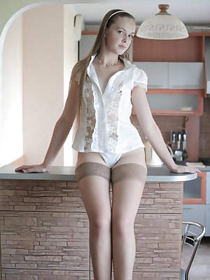Indescribable appetizing angel decided to climb the kitchen table and organize there a little, but thrilling striptease.