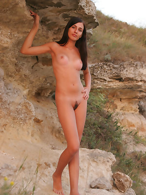 Breathtaking nude angel is seen to pose in front of the huge bridge in the river very naturally without any shade of shame.